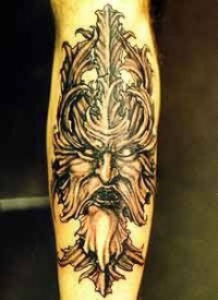 viking tattoo of dark black warrior head