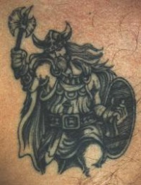 viking warrior with small axe on tattoo
