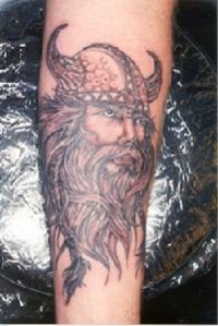 viking tattoo art of warrior head in horned helmet