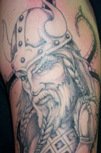 viking warrior head with beard tattoo